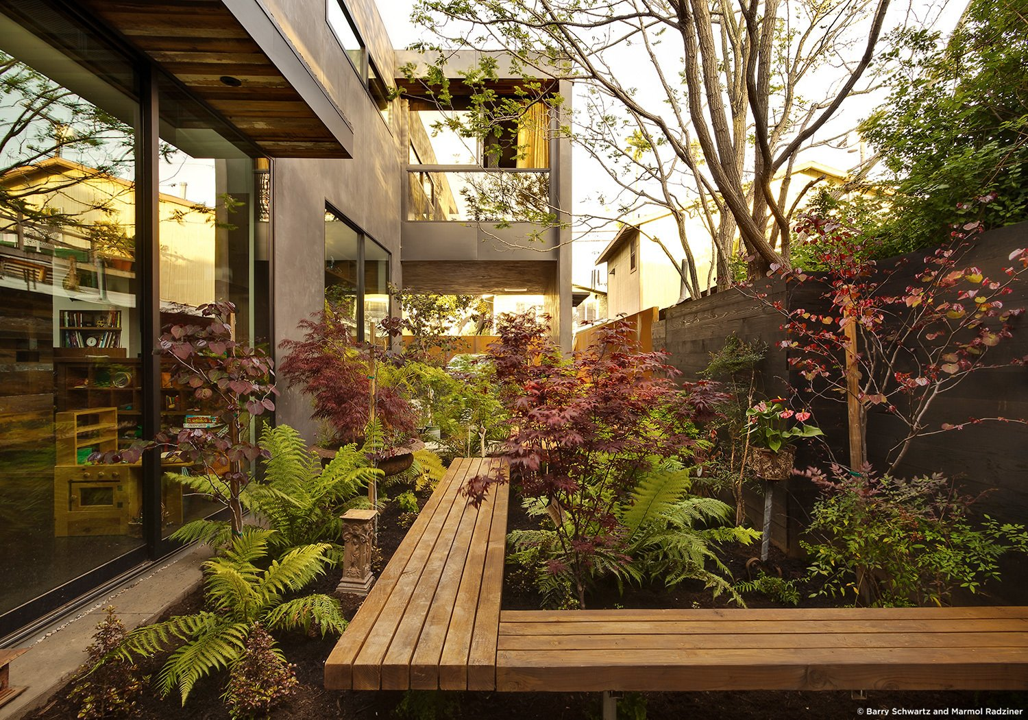#SelaResidence #modern #midcentury #privacy #openness #two-story #lighting #exterior #outside #outdoor #landscape #green #windows #glass #seating #wood #panels #Venice #California #MarmolRadziner  Sela Residence