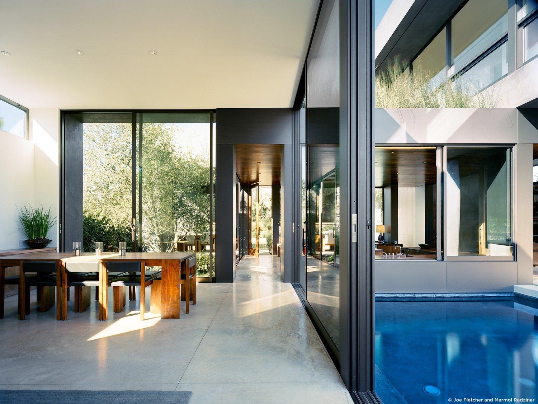 #ViennaWayResidence #modern #midcentury #inside #interior #windows #lighting #dining #wood #table #seating #outdoor #pool #Venice #California #MarmolRadziner  Vienna Way Residence