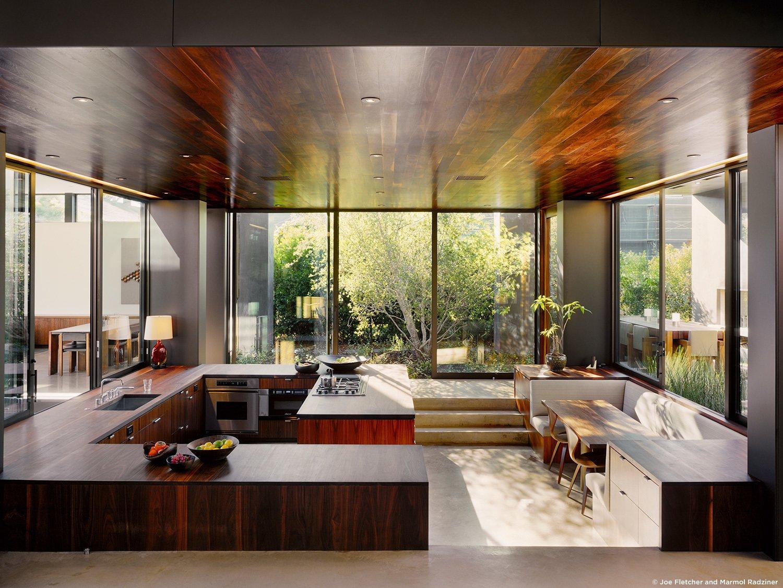 #ViennaWayResidence #modern #midcentury #inside #interior #windows #lighting #kitchen #wood #appliances #table #seating #counter #Venice #California #MarmolRadziner  Vienna Way Residence