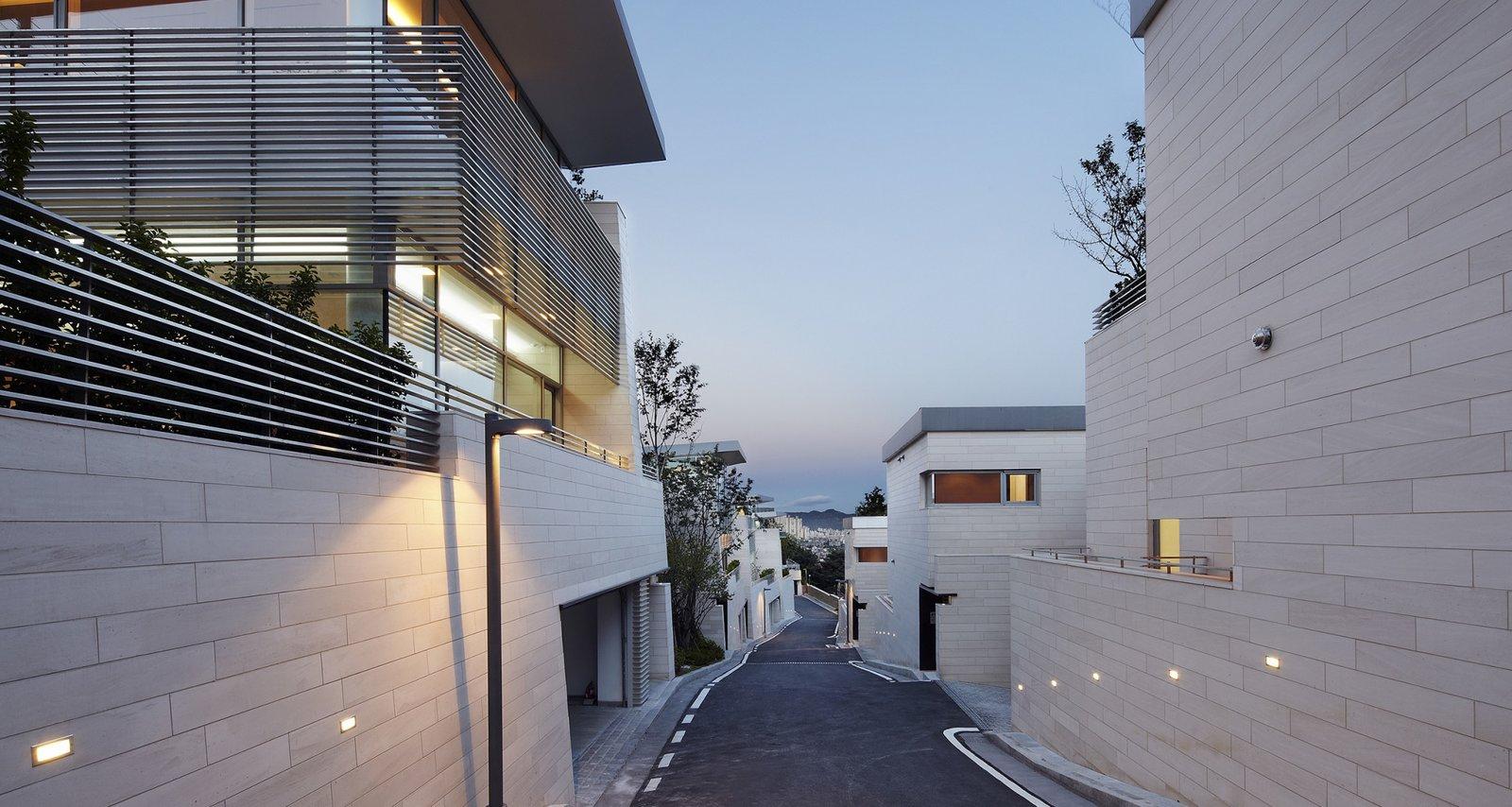 #SeongbukdongResidence #modern #midcentury #enclave #sustainable #L-shaped #exterior #outside #outdoors #structure #street #lighting #geometry #garage #driveway #Seoul #JoelSandersArchitects  Seongbukdong Residence