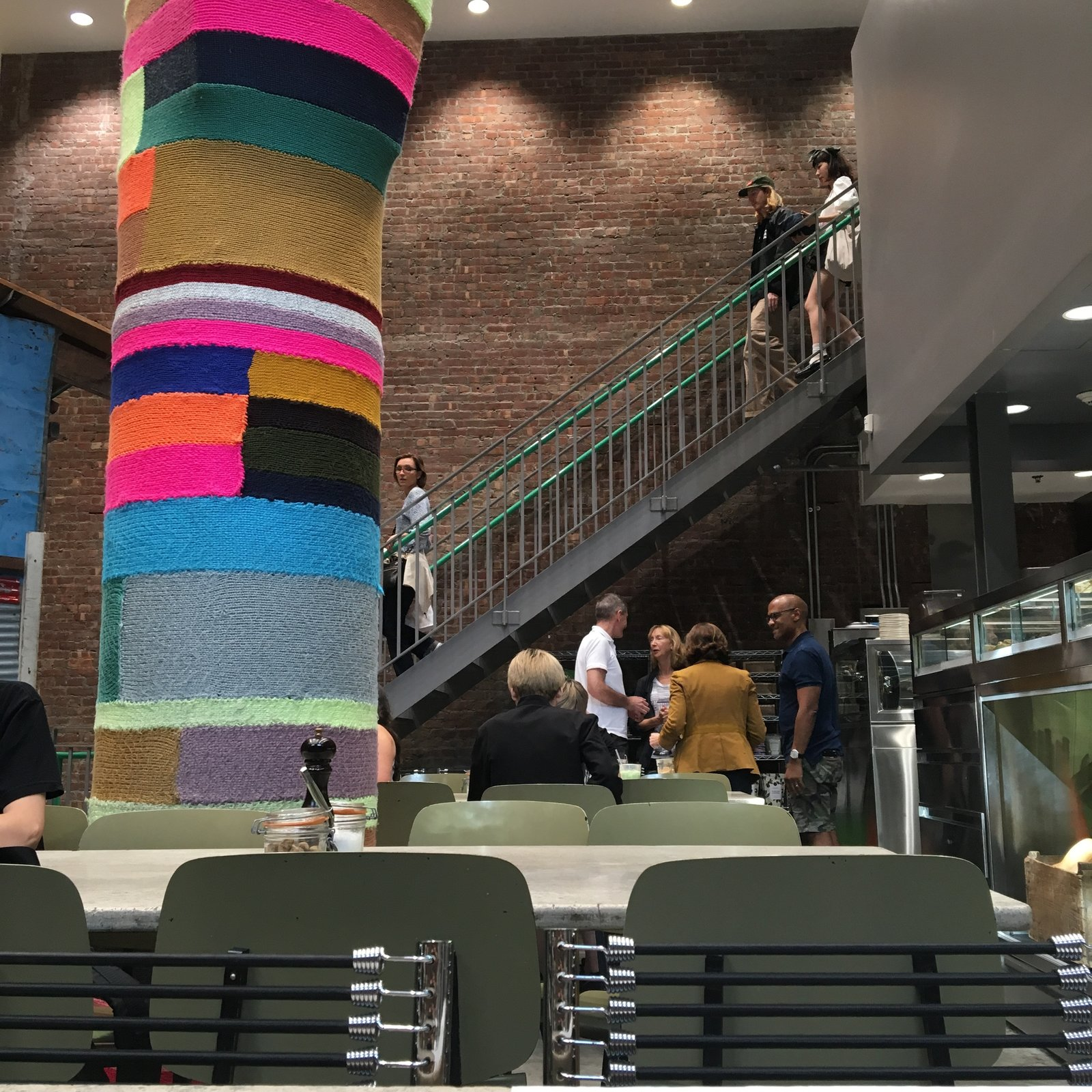 Knitted column by Magda Sayeg, inside the circa-1908 landmarked building in New York, reimagined by Rei Kawakubo as Dover Street Market. Steps from the Dwell office, and my favorite place to get a quick afternoon pick-me-up.  Square Meal