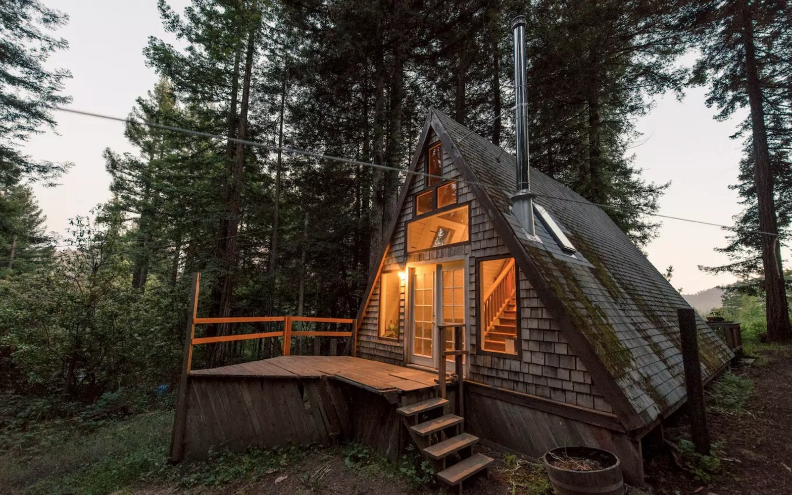 Exterior, Cabin Building Type, A-Frame RoofLine, Wood Siding Material, and Shingles Roof Material Cozy A-Frame Cabin in the Redwoods  https://www.airbnb.com/rooms/2437969  Photo 2 of 11 in 11 Alluring A-Frame Homes You Can Rent Right Now from Travel
