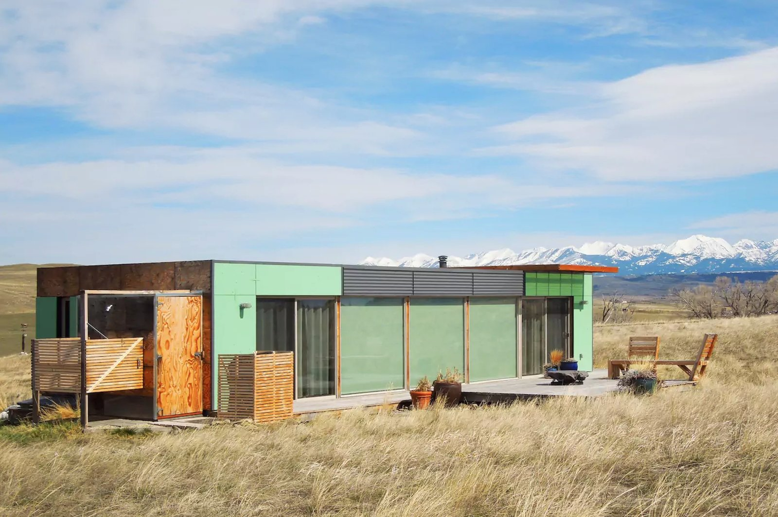 "Shipping Container Home Livingston, MT, United States  Welcome to the ""Little Box on the Prairie"". This unique, modern house is made from two recycled shipping containers, situated on 10-acres of rolling prairie, just North of Livingston Montana. It's a 700 square-foot mix of rustic coziness and clean, modern design. Many of the finishes such as the redwood flooring and plywood wall panels were salvaged off site, recycled and reused. The outside deck is perfect for chatting over morning coffee, an evening glass of wine, gazing at the Absaroka Mountains and likely spotting a deer or antelope. The house comfortably sleeps 2, and a 3rd can sleep on the sofa if needed.  https://www.airbnb.com/rooms/3292920  Amazing Examples of Shipping Container Architecture by Diana Budds from Great Airbnbs"
