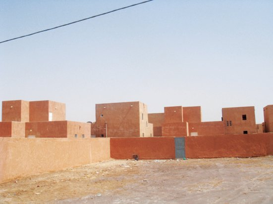 """Adjaye snapped this residential block in Nouakchott, Mauritania. """"Wealthy housing is of the compound and villa type, with Arabic decoration,"""" he says. """"Apartment buildings are normally three or four stories high, and more of them are being built. Low-cost housing is state built and organized in quarters.""""   David Adjaye's African Architecture Photo Survey"""