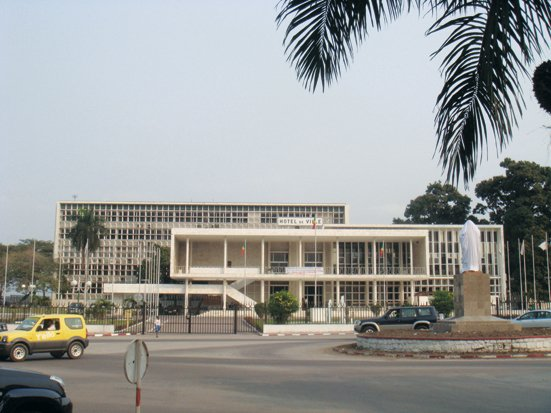 """Adjaye took this photo of a civic building in Brazzaville, Republic of the Congo. """"Often dilapidated, these buildings are slowly being brought back to full use. City hall has touches of Terragni, constructed of white marble with fine brises-soleil. More recent administrative buildings have a tendency towards White House pastiche, a 90-degree turn from the city's modernist legacy.""""  David Adjaye's African Architecture Photo Survey"""