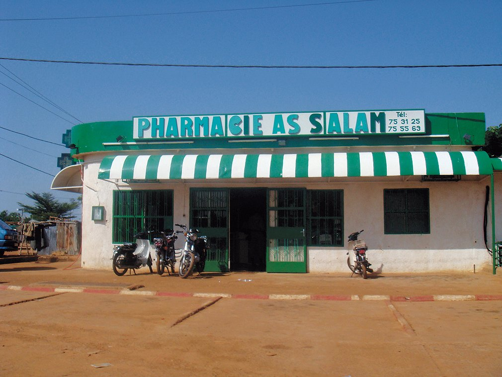 """""""Most houses are of the compound type. In poor areas, the countryside seems to invade the city, creating an in-between place of earth, mud, straw, wood, concrete and render."""" This commercial storefront was snapped in Niamey, Niger.  David Adjaye's African Architecture Photo Survey"""