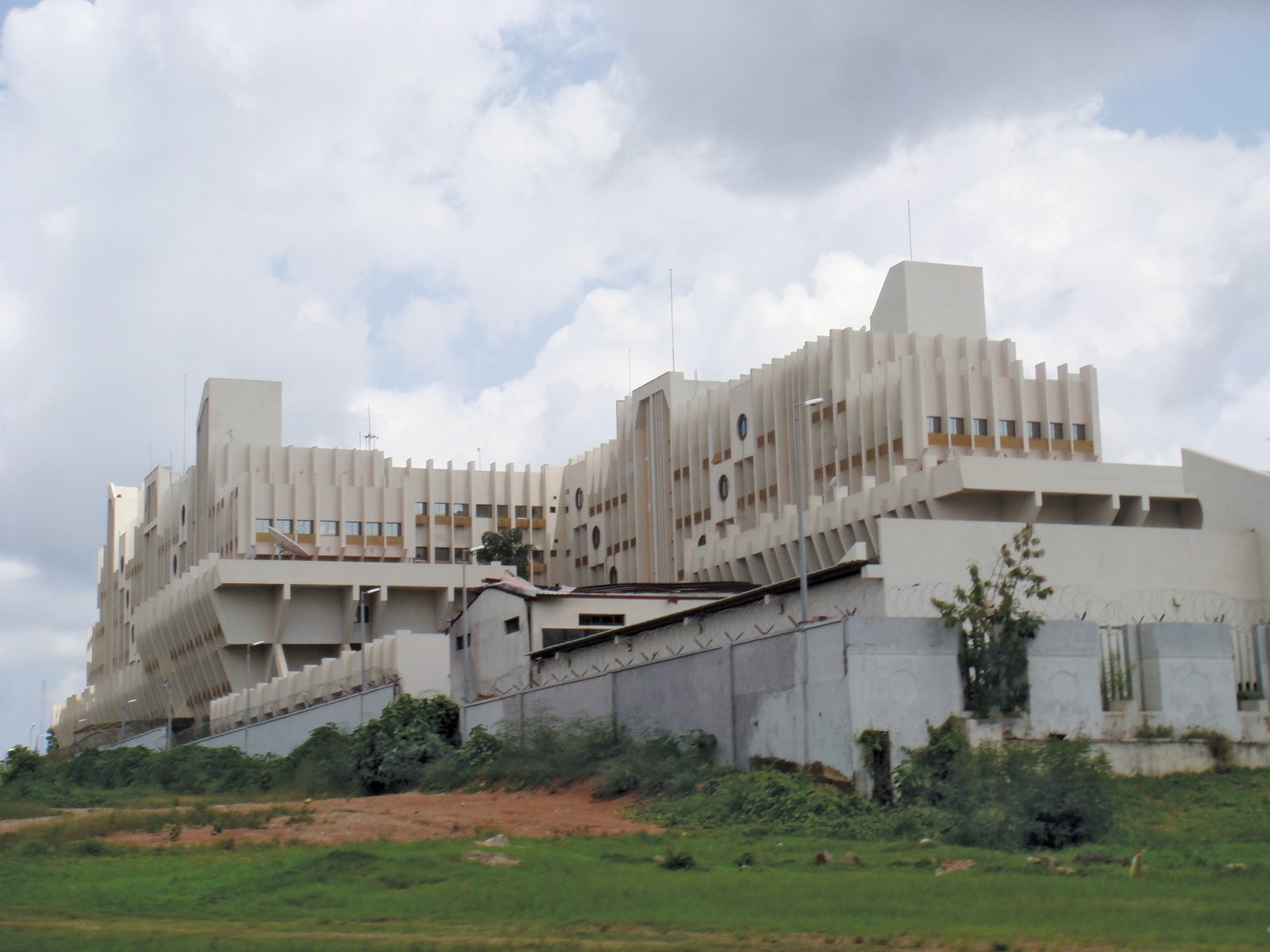 """Visiting Abuja, Nigeria, Adjaye notes: """"The architecture of the public buildings is intended to present Abuja as the country's symbolic Center of power. Key government buildings, the cathedral and the main mosque occupy conspicuous sites in the center of the city.""""  David Adjaye's African Architecture Photo Survey"""