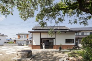 In an agricultural town in Japan's Yamanashi prefecture, a derelict sake warehouse was salvaged by the people of the town and turned into a community venue with an interior stage for meetings and performances.