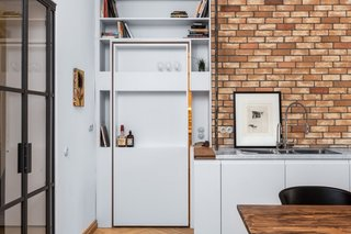 A view of the pivoting shelf door from the kitchen and dining area.