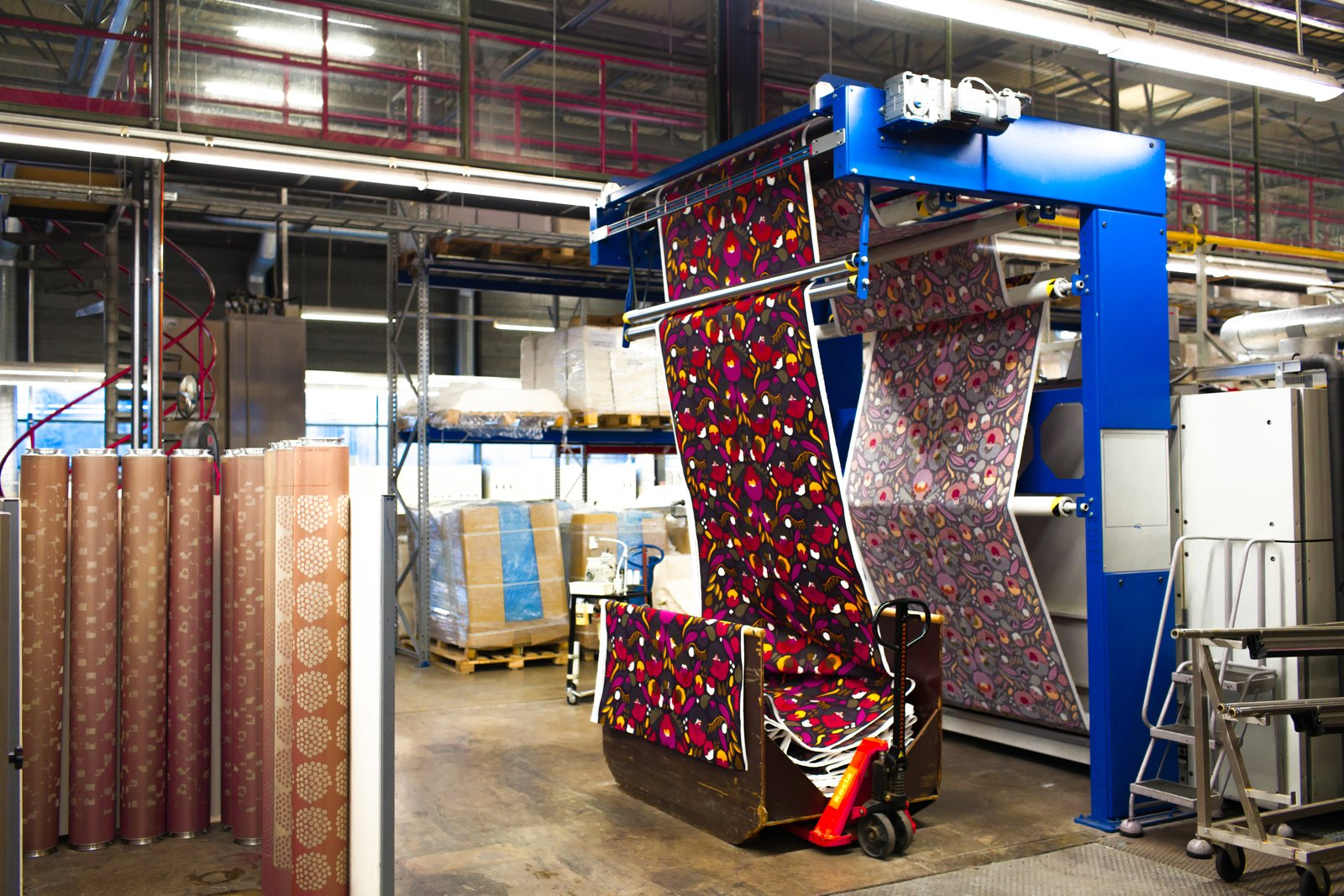 Once printed, fabrics are run through a mechanical dryer, which presses and sets all the layers of color in place. Marimekko's team then inspects and views each roll of textile by eye for any mistakes along process. Approved rolls are then shipped off to vendors and, in some cases, make their way onto any of the brand's myriad clothing items, products, or home accessories.  Photo 6 of 7 in For Marimekko's  Artwork Studio Manager,  Print's Not Dead