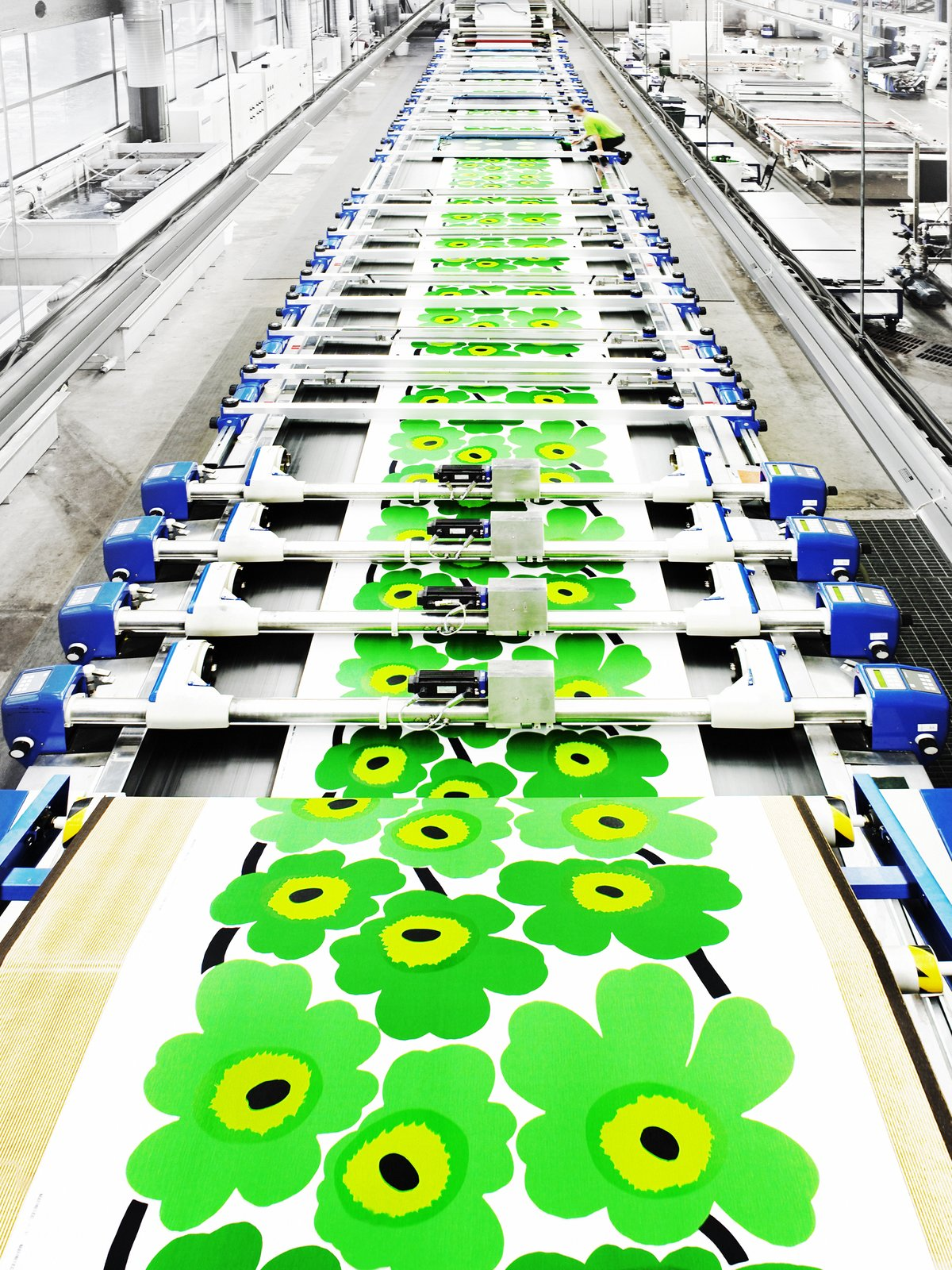 Once the screen printed graphic is finalized and approved by the creative and production teams, the pattern is printed onto cotton fabrics using long flatbed machines.  Photo 5 of 7 in For Marimekko's  Artwork Studio Manager,  Print's Not Dead