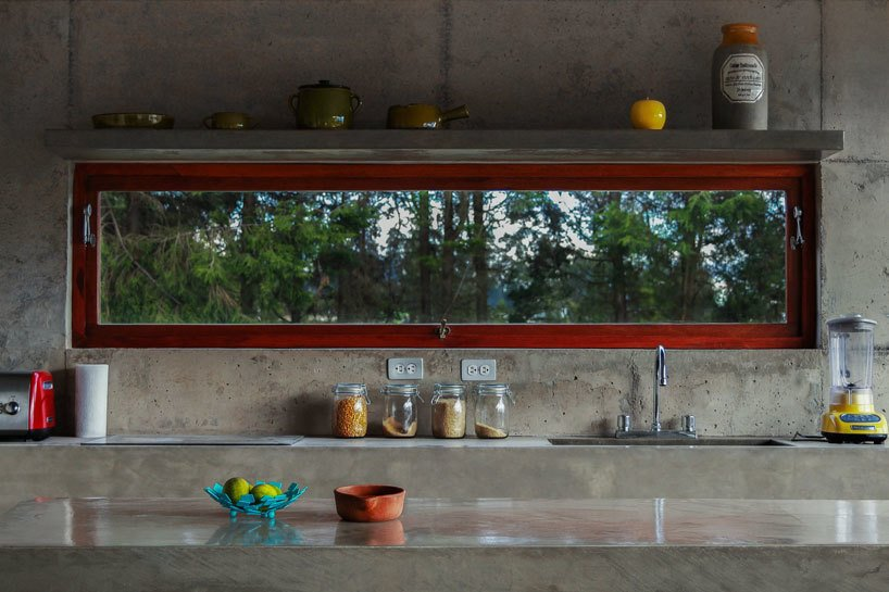 Kitchen and Concrete Counter Poured by hand on site, nearly the entire structure of the El Quinche House—including the kitchen counters and sinks—was made of concrete sourced from a local quarry.  Photos from With a View of the Andes, This Concrete Retreat in Ecuador Follows the Sun