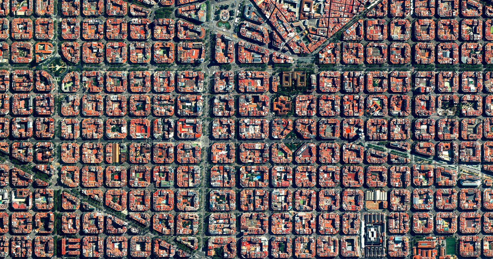 Clusters of housing with communal courtyards are placed along a strict grid pattern in Barcelona's Eixample district, shown here. Reprinted with permission from Overview by Benjamin Grant, copyright (c) 2016. Published by Amphoto Books, a division of Penguin Random House, Inc. Images (c) 2016 by DigitalGlobe, Inc.  Ever Wondered About the View from Space?