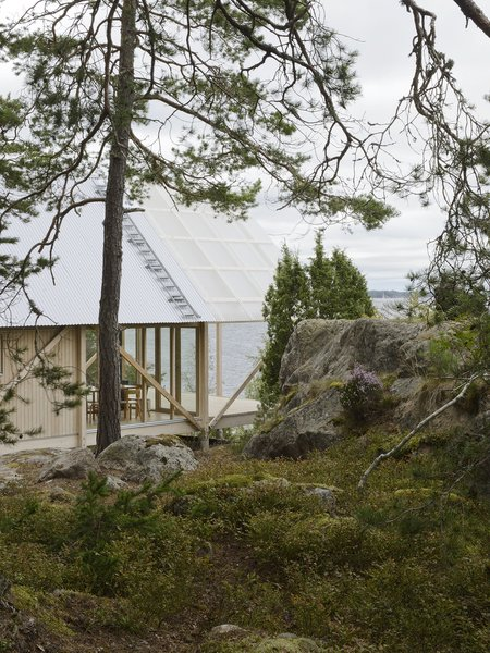 On Viggsö, an island of the Swedish Archipelago, architecture firm Arrhov Frick designed a two-story retreat, using simple but hardy materials. The roof, made from corrugated metal and fiber-reinforced plastic, joins the pine timber frame.