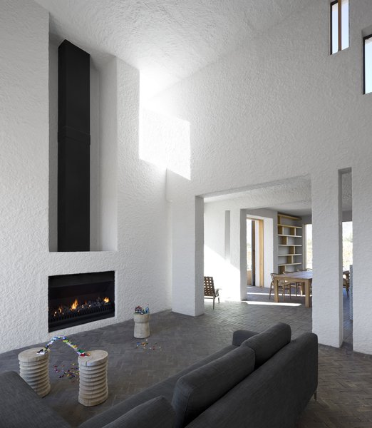 Living Room and Standard Layout Fireplace Soaring ceilings and a fireplace mark the home's main living area.  Photo 3 of 7 in A Minimalist Retreat at the Edge of South Africa's Karoo Desert