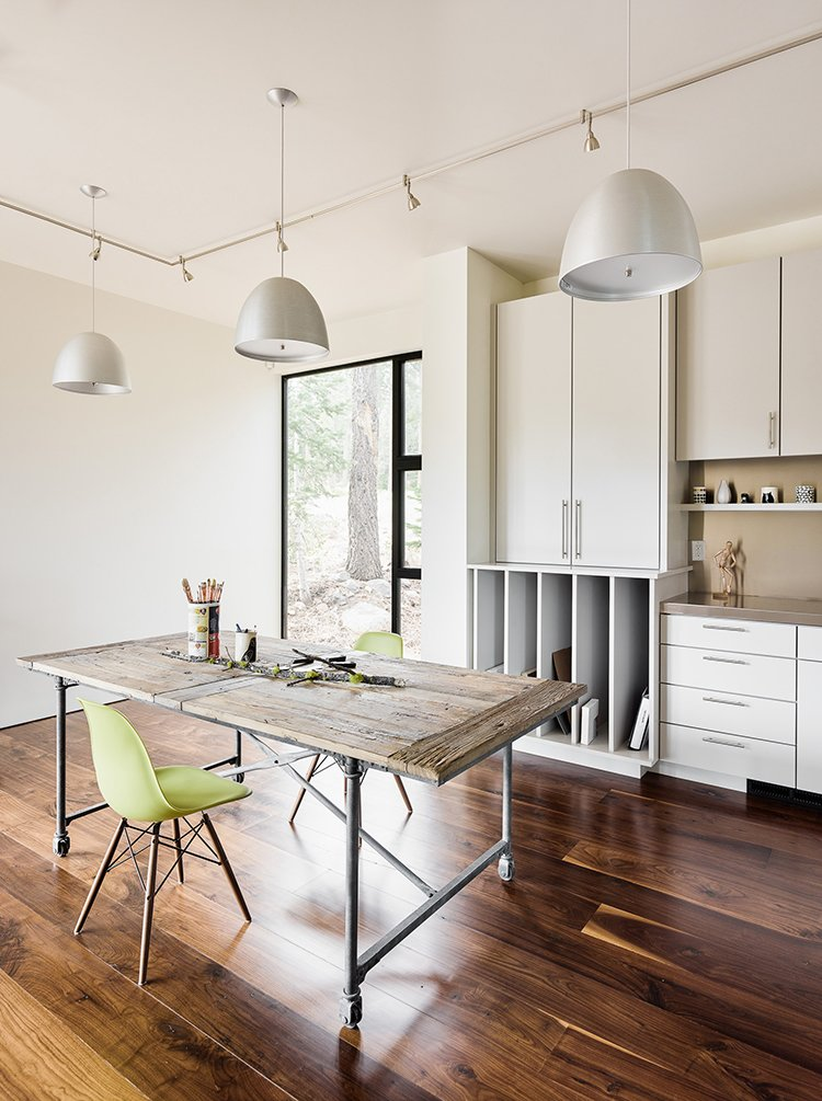 Dining Room, Table, and Chair To maximize the space for guests, the structure features six private sleeping areas, including two that do double duty, like this space that incorporates an office.  Best Photos from A Family's California Ski Retreat is Designed to Blend in With Its Site