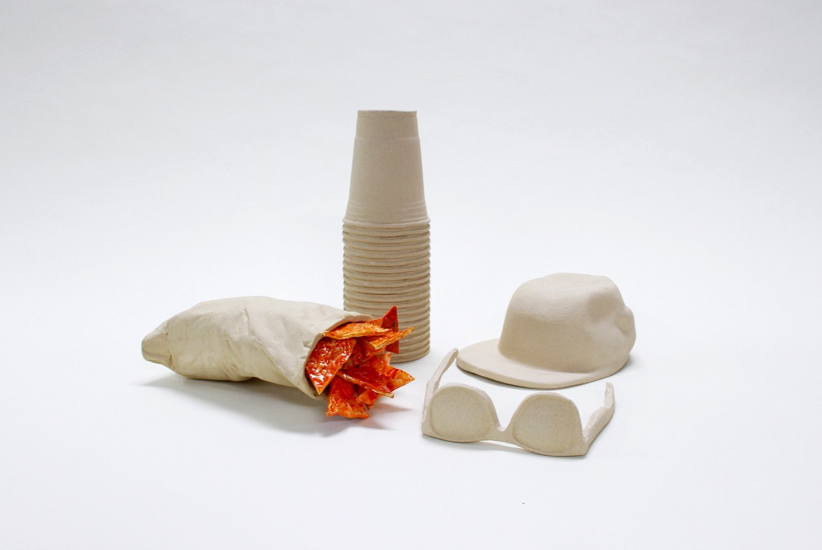 You'll think twice before leaving your belongings behind at the beach this summer when you've got them immortalized in ceramic back at home thanks to Wyatt Little's Beach Stuff.  Photo 7 of 7 in A New Design Exhibition Solves Problems You Didn't Know You Had
