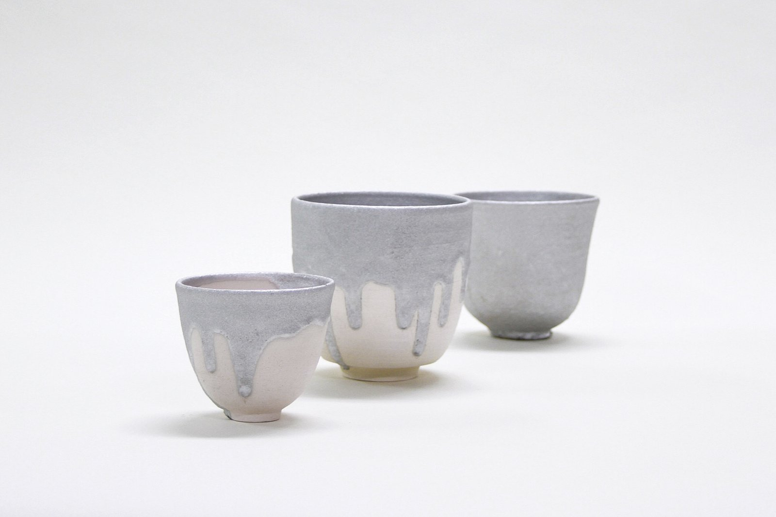Gil Sunshine's Karnak Glazed Cups take industrial design to a different level—from the roof of your building to the roof of your mouth—with a series of ceramics caked in flashing cement.  Photo 6 of 7 in A New Design Exhibition Solves Problems You Didn't Know You Had