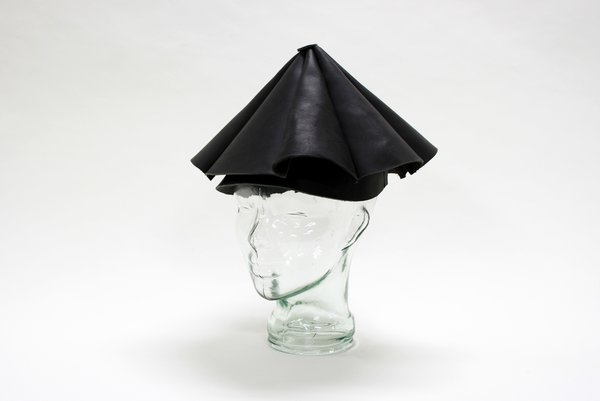 The Leather Umbrella Hat by Yield Design promises to be your shelter in the storm. A hands-free rain solution made 100 percent from leather: What could go wrong?  Photo 2 of 7 in A New Design Exhibition Solves Problems You Didn't Know You Had