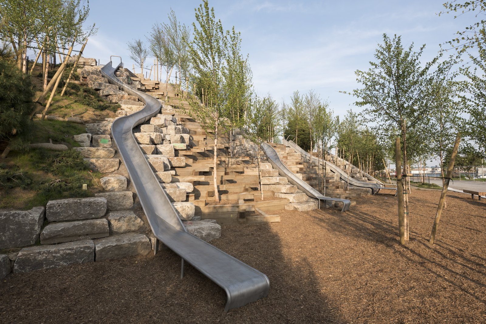 Slide Hill offers an interactive platform for play that includes a universally accessible path and the longest sliding board in the city.  Photo 2 of 6 in New York's Newest Park Sits on Recycled Demolition Debris