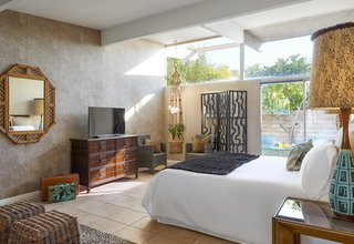 The new hotel's Jungle bedroom, stocked with finds from places like The Estate Sale Company, where it's not unusual to find treasures from the Parker Palm Springs, located just across the street. Other scores came from the now-shuttered Lot 58 auction house.