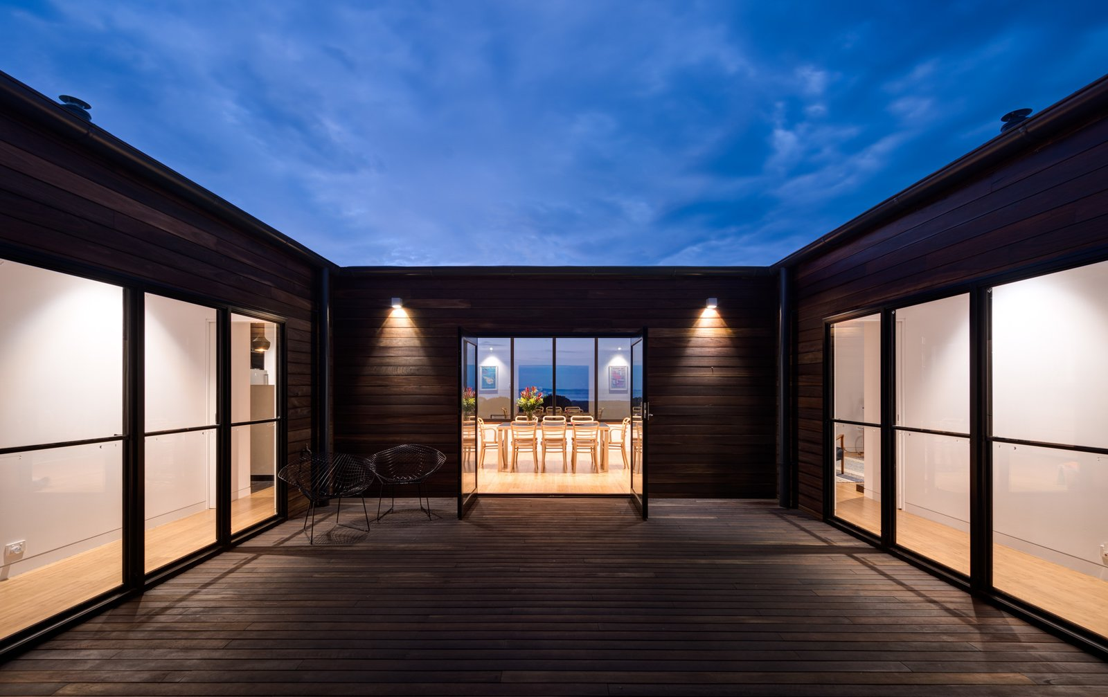 Outdoor, Back Yard, Large Patio, Porch, Deck, and Wood Patio, Porch, Deck A courtyard at the center of the home offers an outdoor space with protection from the harsh coastal winds.  16+ Prefab Homes in the Middle of Nowhere