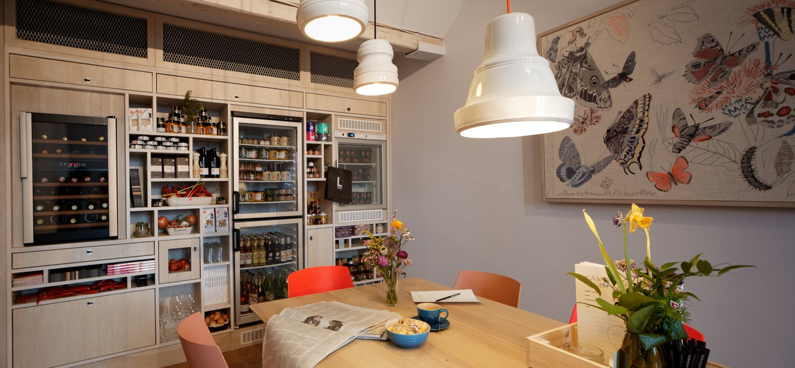 The fifth floor of the hotel features Lekker, a mini grocery store that's open 24/7. Guests can cook here or in their private rooms.  Photo 5 of 8 in Inspired by the Sharing Economy, This Frankfurt Hotel Feels Just Like Home