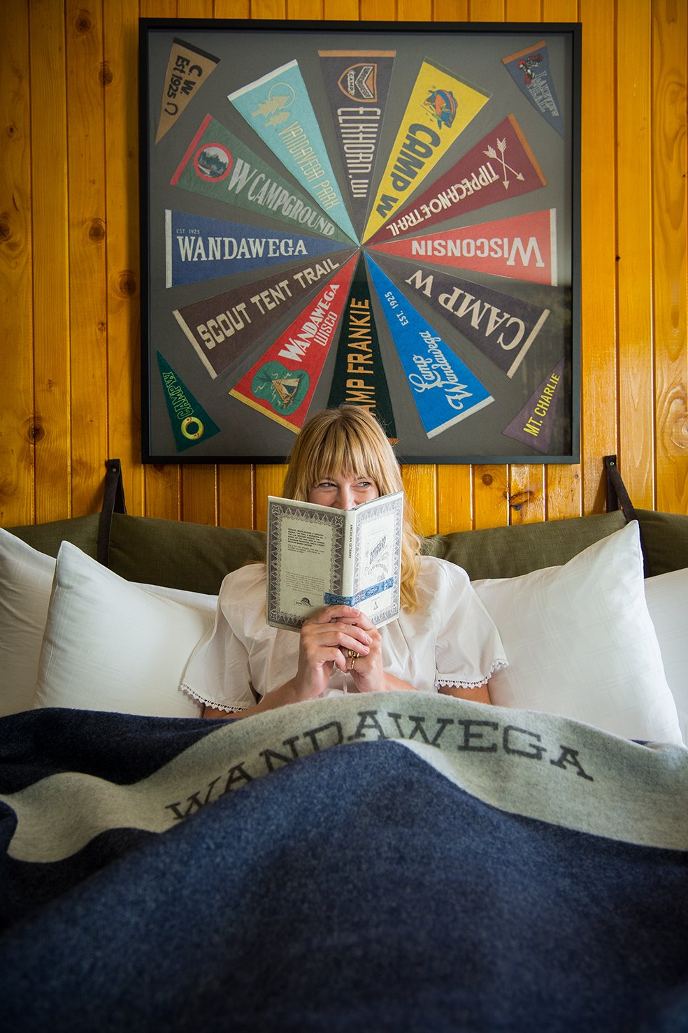 Bedroom and Bed The walls of the suite's main room are lined with amber-shellacked pine, recalling Wandawega's cabins—and retro family basements.  Graduate Madison from This Wisconsin Hotel Suite Conjures the Best of Summer Camp—Hold the Bug Spray