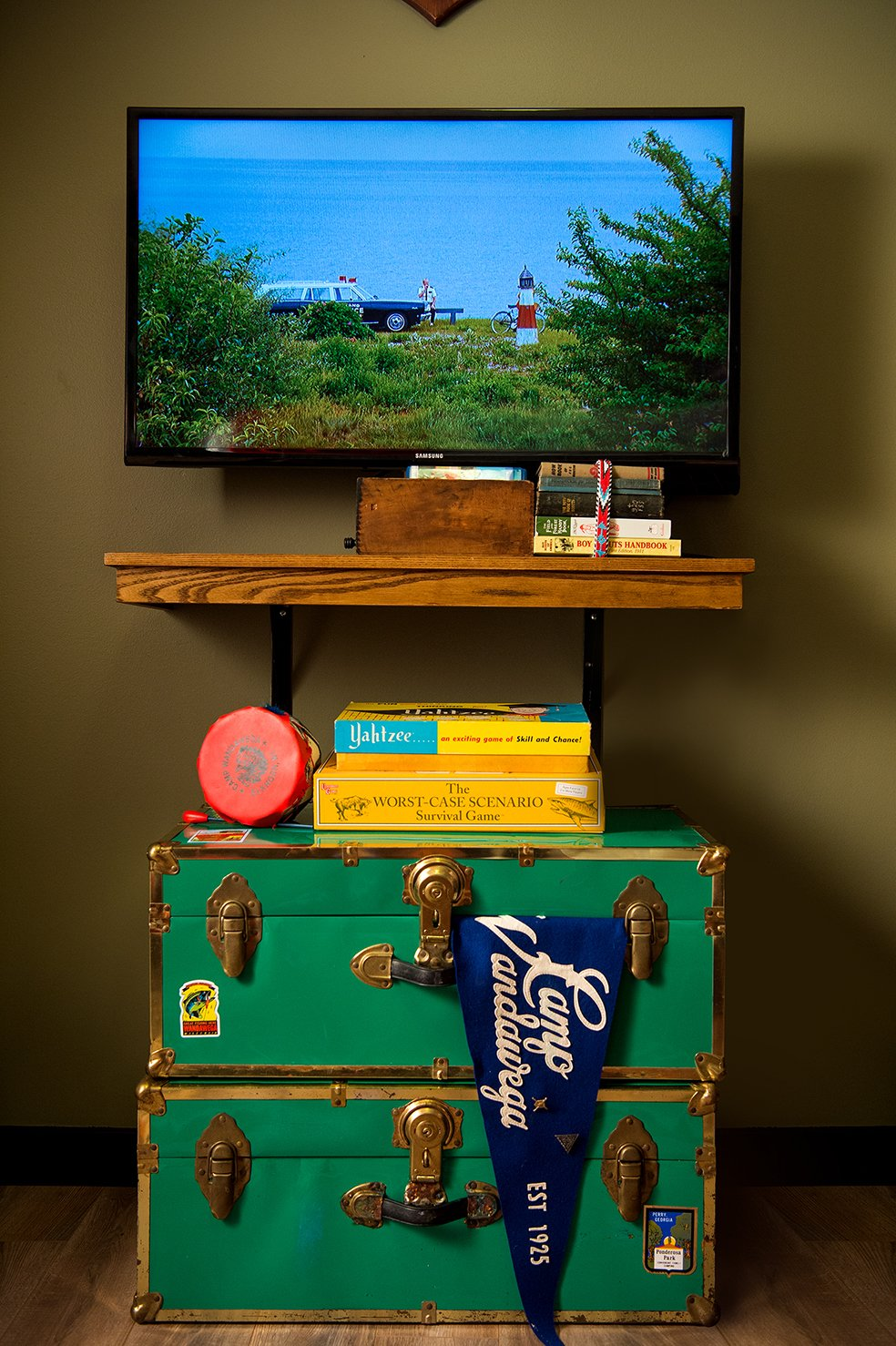 Bedroom and Storage The room comes fully stocked with a collection of camp-themed movies.  Graduate Madison from This Wisconsin Hotel Suite Conjures the Best of Summer Camp—Hold the Bug Spray