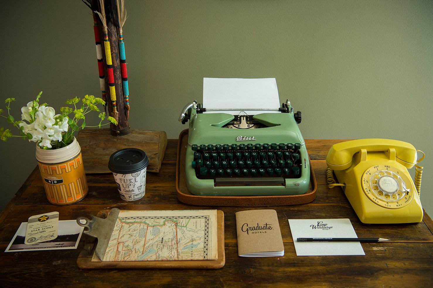 Office and Desk A working vintage typewriter and telephone top the antique desk.  Photo 6 of 10 in This Wisconsin Hotel Suite Conjures the Best of Summer Camp—Hold the Bug Spray