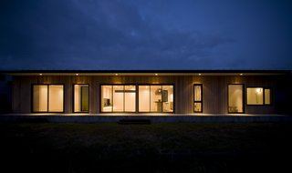 Vast expanses of windows connect the home to its site.