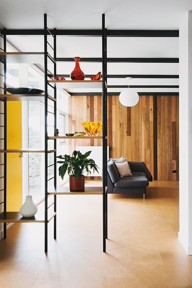 Living Room and Sofa Open shelving lends an organizing grid without obstructing views.  Photo 7 of 15 in An Australian Renovation Gives New Life to Midcentury Style
