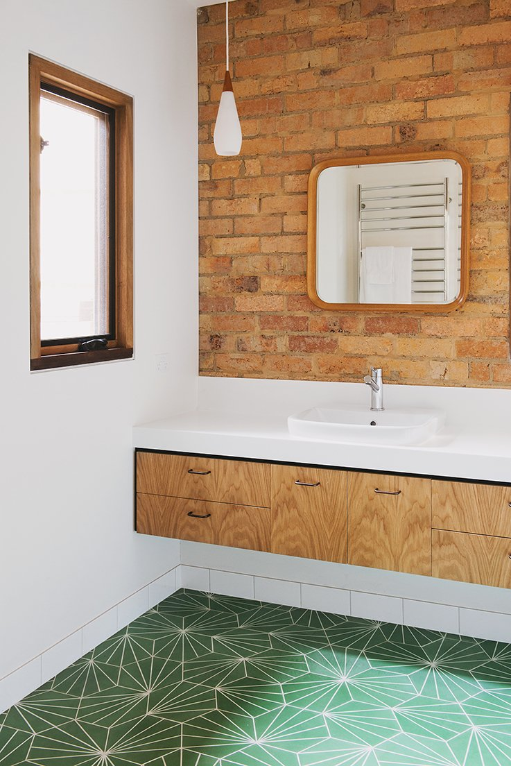 Bath Room The residents chose the bathroom's Pikralida Green tiles from Tilenova in Sydney.  Photo 14 of 15 in An Australian Renovation Gives New Life to Midcentury Style