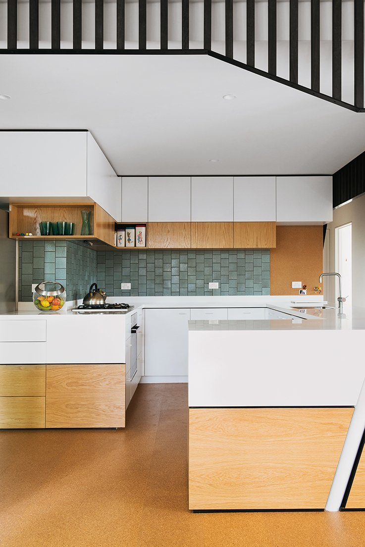 Kitchen, White Cabinet, and Ceramic Tile Backsplashe The backsplash tiles were imported from American manufacturer Heath Ceramics, in the Chalk-Gunmetal finish from the Classic Field line.  Photo 15 of 15 in An Australian Renovation Gives New Life to Midcentury Style