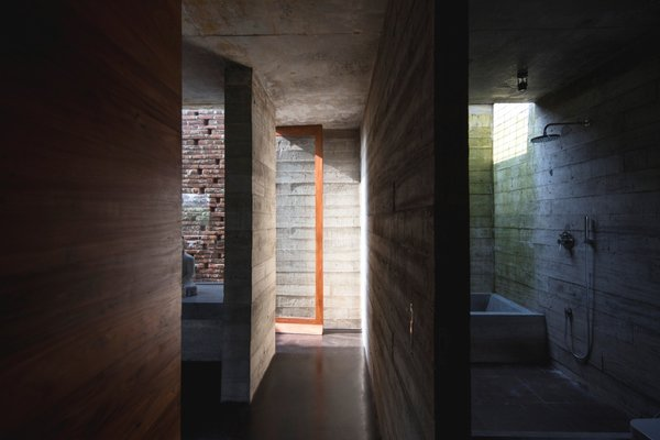 Brick and board-formed concrete are the primary materials of the rugged, yet elegant, structure.