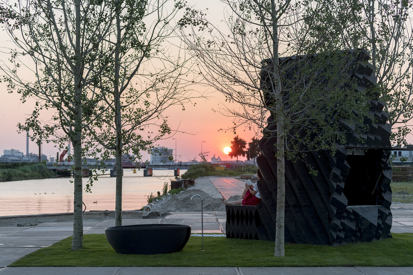 The Urban Cabin sits within a pocket park complete with poplar trees designed by Delva Landscape and Boomkwekerij Ebben.  Photo: Ossip van Duivenbode  Photo 18 of 19 in Stay in This 3D-Printed Tiny House