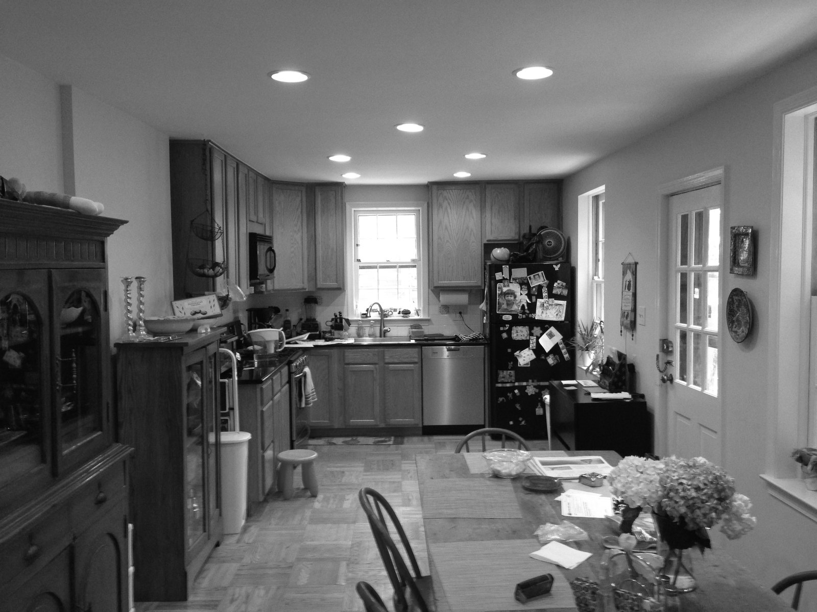 The original kitchen was cramped and cluttered.  Photo 5 of 9 in Philadelphia Row House Renovation