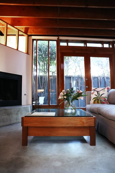 Kristin, who often creates custom projects for private clients, designed the Horizon coffee table as a birthday gift for William. Its glass and teak are meant to recall the materials in the house.  Photo 10 of 12 in Peek Inside the Frank Gehry Rental of an Emerging L.A. Furniture Designer