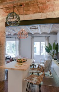 The open kitchen is the centerpiece of the renovated apartment. Bloomint designed the island.