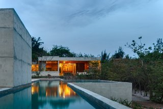 The house is laid out as a linear series of structures.