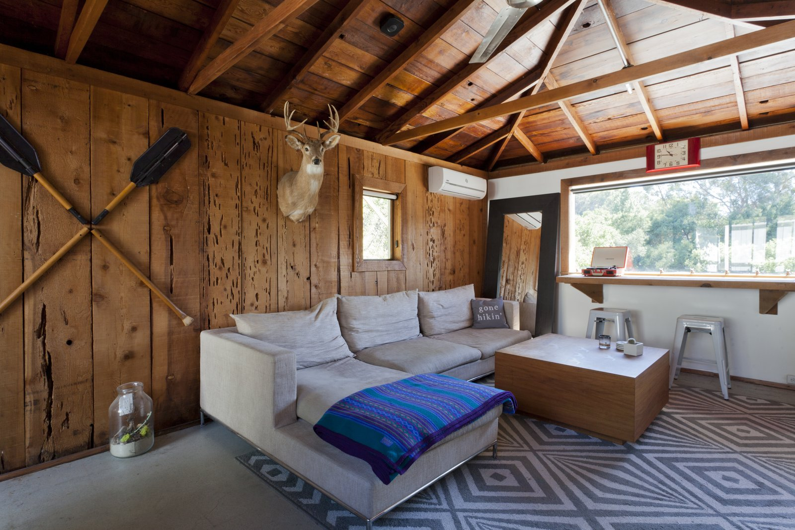 The guesthouse is clad in cedar with a raw redwood ceiling.  Photo 11 of 11 in Graphic Design Inspired This Handcrafted Canyon Hideaway