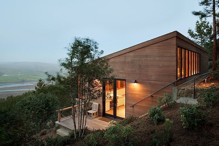 Exterior, House Building Type, Cabin Building Type, Wood Siding Material, and Shed RoofLine On a scenic one-acre site in Inverness, California, Richardson Architects planted an artist studio in a hillside overlooking a coastal vista. The client, a painter who lives on the property, requested the addition be situated downhill from the main residence to create distance between work and home.  Photo 2 of 4 in The View at This Art Studio Could Inspire a Masterpiece