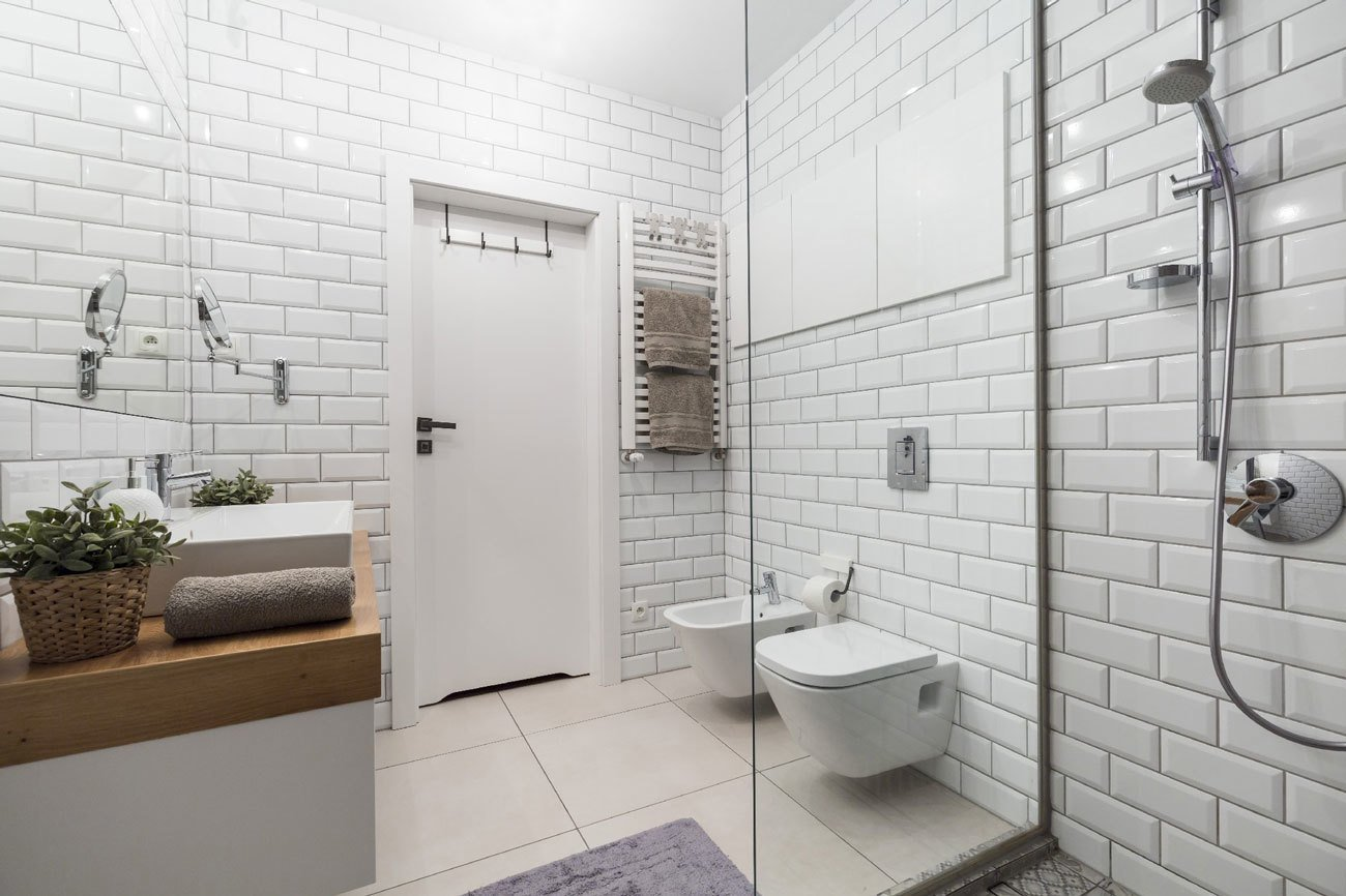 Bath, Ceramic Tile, Vessel, Full, Wood, Subway Tile, and One Piece Subway tile, another fixture of the urban landscape, envelops the bathroom.  Bath Ceramic Tile Subway Tile One Piece Photos from Rarely Do Family Homes  Look So Raw