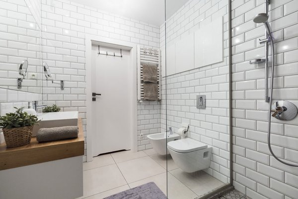 Subway tile, another fixture of the urban landscape, envelops the bathroom.