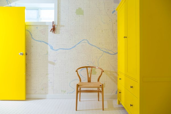 While addressing plumbing problems, the residents took time to spruce up the bathrooms, adding new tile, fixtures, and, in one, a cheery yellow cabinet.  Photo 24 of 25 in 25 Bold Ways to Decorate with Yellow from This Century-Old Bungalow Is an Eternal Work-in-Progress