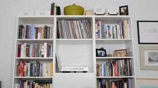An IKEA shelf in the guest room displays an Orbit Turntable by U-Turn.