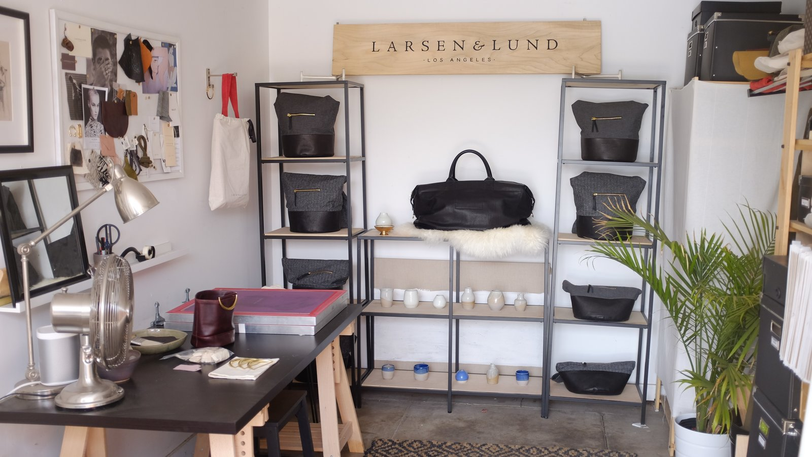 Fashion designer Lindsey Lund Mortensen's half of the studio some of her creations as well as a inspiration board.  Photo 4 of 7 in The L.A. Home of Song Exploder's Hrishikesh Hirway Is Barely Larger  Than a Music Box