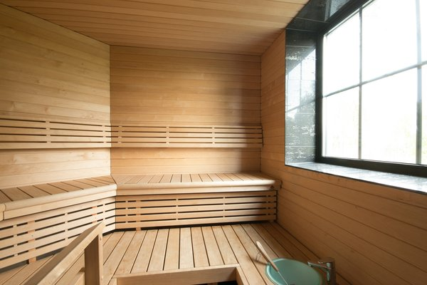 The home includes a traditional Finnish sauna clad in birch.