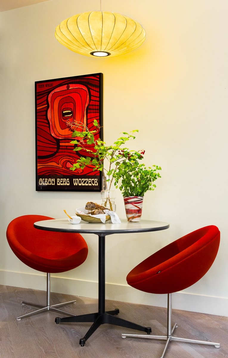 Architectural designer Daniel Ian Smith revamped his garden apartment in Manhattan's West Village after Superstorm Sandy hit in 2012. The original George Nelson lamp is an heirloom from his great aunt. The Soviet-era theater poster is from Poland.  Photo 2 of 5 in After Sandy, an NYC Designer Rehabs His Ruined Apartment—and Lends Neighbors a Hand with Theirs