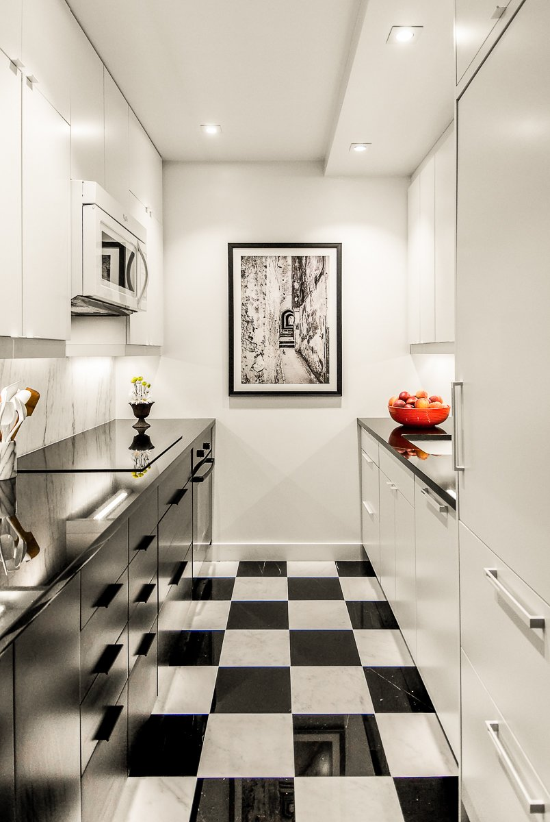 The 650-square-foot apartment has a galley kitchen with checkered black-and-white tile.  Photo 3 of 5 in After Sandy, an NYC Designer Rehabs His Ruined Apartment—and Lends Neighbors a Hand with Theirs